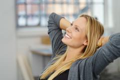 Thoughtful Office Woman Relaxing at her Desk - stock photo