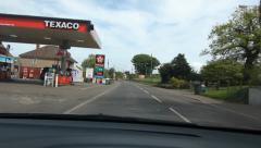 Stopping at Texaco petrol station in Chilcompton, UK. - stock footage