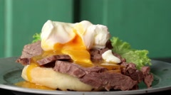 Rotating spotted plate with Homemade sandwich with baked meat and soft-boiled Stock Footage