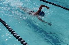 Boy training for freestyle stroke swimming - stock photo
