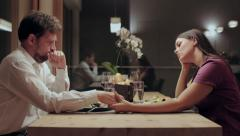 Sad couple after loss at table feeling bad - stock footage