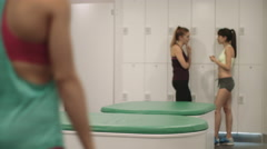 Young women relaxing in changing room after work out Stock Footage
