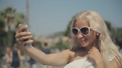 Woman doing selfie in azure shore of Nice Stock Footage
