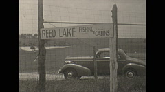Stock Video Footage of Vintage 16mm film, 1938, Illinois, Reed lake cabin and car