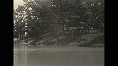 Stock Video Footage of Vintage 16mm film, 1938, Illinois, Reed lake cabin scenic
