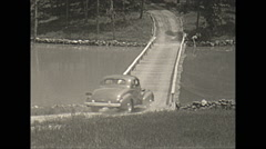 Vintage 16mm film, 1938, Illinois, Reed lake car crosses bridge Stock Footage