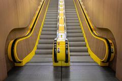 Yellow Escalator Leading Up Stock Photos
