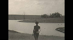 Vintage 16mm film, 1938, Illinois, Reed lake pretty young woman in bathing suit Stock Footage