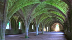 The beautiful arched interior of Fountains Abbey in England. - stock footage