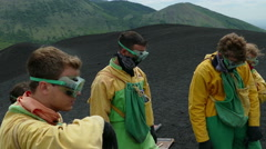 Vulcano boarders are getting ready for the descent Stock Footage