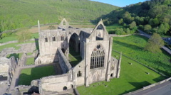 An amazing aerial view over the Tintern Abbey in Wales, United Kingdom. Stock Footage