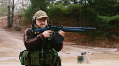 Man shooting a shotgun Stock Footage