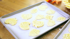 Cutting out Autumn leafs with cookie stamper to decorate pumpkin pie. Stock Footage