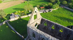An amazing reverse reveal aerial view over the abandoned Tintern Abbey in Wales, - stock footage