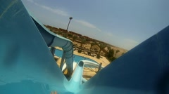 Water slide POV with tube tunnel at waterpark amusement center Stock Footage
