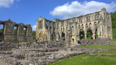 An establishing shot of Rievaulx Abbey abandoned cathedral in England. Stock Footage