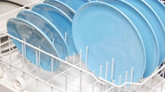 Loading dishes in dishwasher Stock Footage