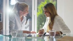 4K Attractive businesswomen discussing sales charts in light modern office Stock Footage