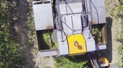 Close up of harvester machine picking grapes aerial view Stock Footage