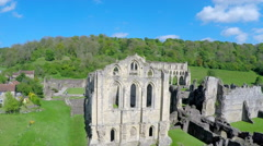 A rising reveal aerial shot of Rievaulx Abbey in England. Stock Footage