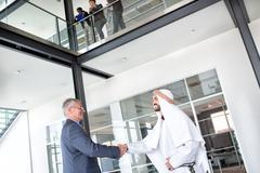 Stock Photo of Director of company receive Arabian businessman