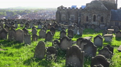 Old stone headstones are found in a British cemetery. - stock footage
