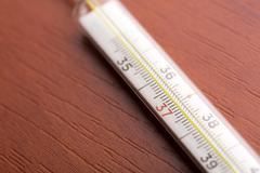 Thermometer on the table - stock photo