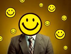 Businessman with smiley face instead of head - stock photo