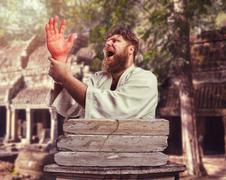 Strong karateka with an injured hand - stock photo