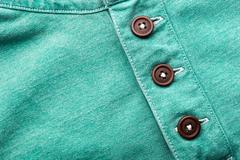Buttons on cloth - stock photo