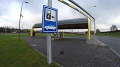 Traffic sign of electric vehicle charging station and in background 4k - stock footage