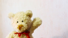 Toy teddy bear waving his paw Stock Footage