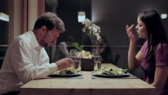 Woman angry in restaurant with husband eating salad Stock Footage