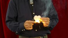 Magician Creates a Rose From Fire - stock footage