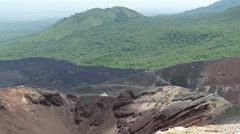Active Cerro Negro volcano crater with smoke Stock Footage