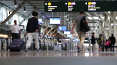 Night shot of passengers with luggage inside YVR airport Stock Footage