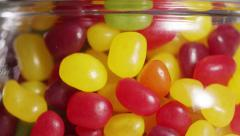 Close up of a child's hand taking a handful of candy from a sweet jar Stock Footage