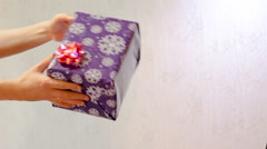 Male hand pass in the box gift box female hands Stock Footage