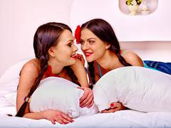 Two sexy lesbian women  erotic foreplay game in bed Stock Photos