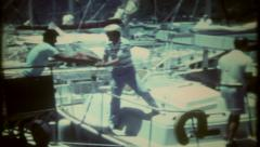 2810 - loading supplies on sailboat for ocean voyage - vintage film home movie - stock footage