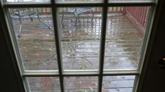View through back door of rain on old wood deck Stock Footage