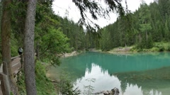 Panorama to Boat in Mountain Lake Lago Di Braies  4k Stock Footage