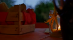Basket on a table with a candle beside Stock Footage