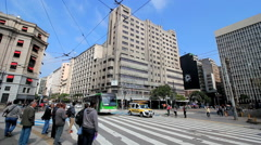 Time lapse of people and vehicles - Sao Paulo, Brazil. Crossing intersection Stock Footage
