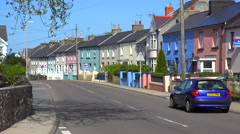 A quaint street of multicolored houses in a small village in Wales. - stock footage