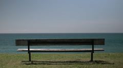 Empty bench on lake. Stock Footage
