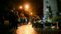 France, Embassy in Kiev, Ukraine. Flowers and candles memorable memorial. - stock footage