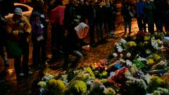 Flowers and candles memorable memorial, French Embassy in Kiev, Ukraine. - stock footage