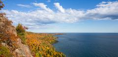 Panorama of Colorful Lake Superior Shoreline with Dramatic Sky - stock photo