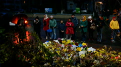 Flowers and candles memorable memorial, French Embassy in Kiev, Ukraine. Stock Footage